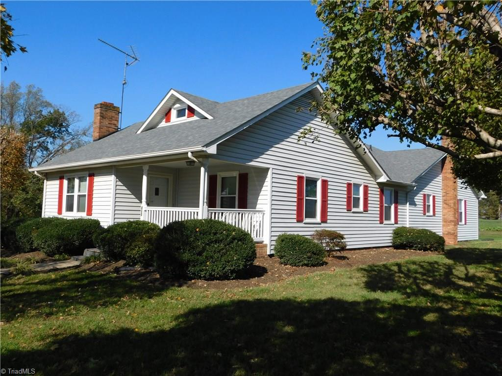 Beautiful country home with spacious rooms.  Large kitchen for family gatherings. Island, custom cabinets made by seller. New dishwasher & hood.  LR with gas log fireplace and walnut mantle. Master suite double sinks, jetted tub/shower and large walk in closet. Beautiful hardwoods.  Upstairs bonus room could be sewing, storage, office or play area, heated but not cooled. Life time window guarantee  Window World. Over size dble garage with unfinished basement access. New roof house & building 30 yr.
