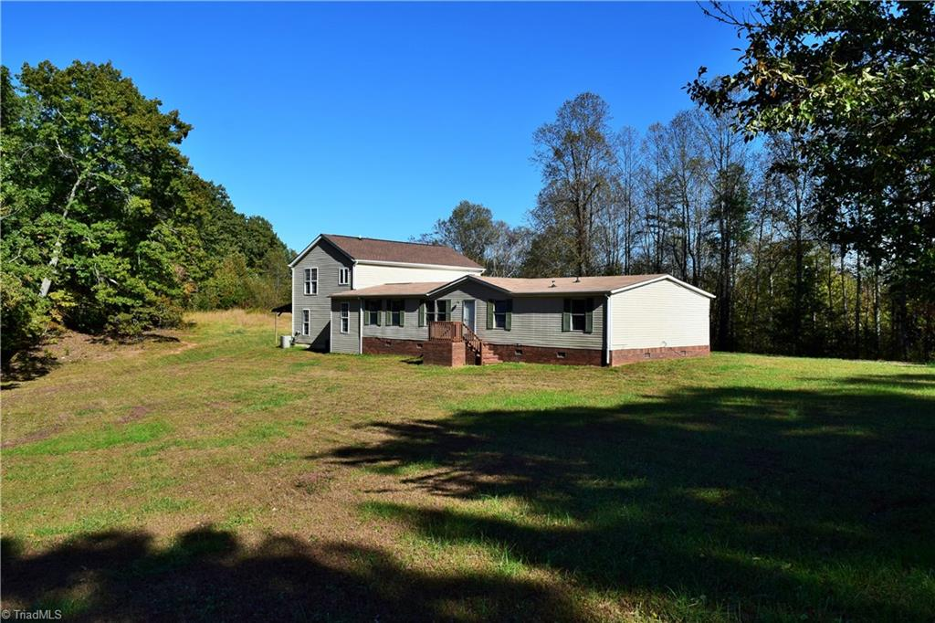 Large family or Combined family? Space is no problem in this 5 bdrm 3 bath home on 5 acres. Two master bdrms to choose from, large kitchen with 2 full size sinks, Large laundry and mudroom. Great room and one mbr on the upper level with full bath. Additional 5.62 acres available.