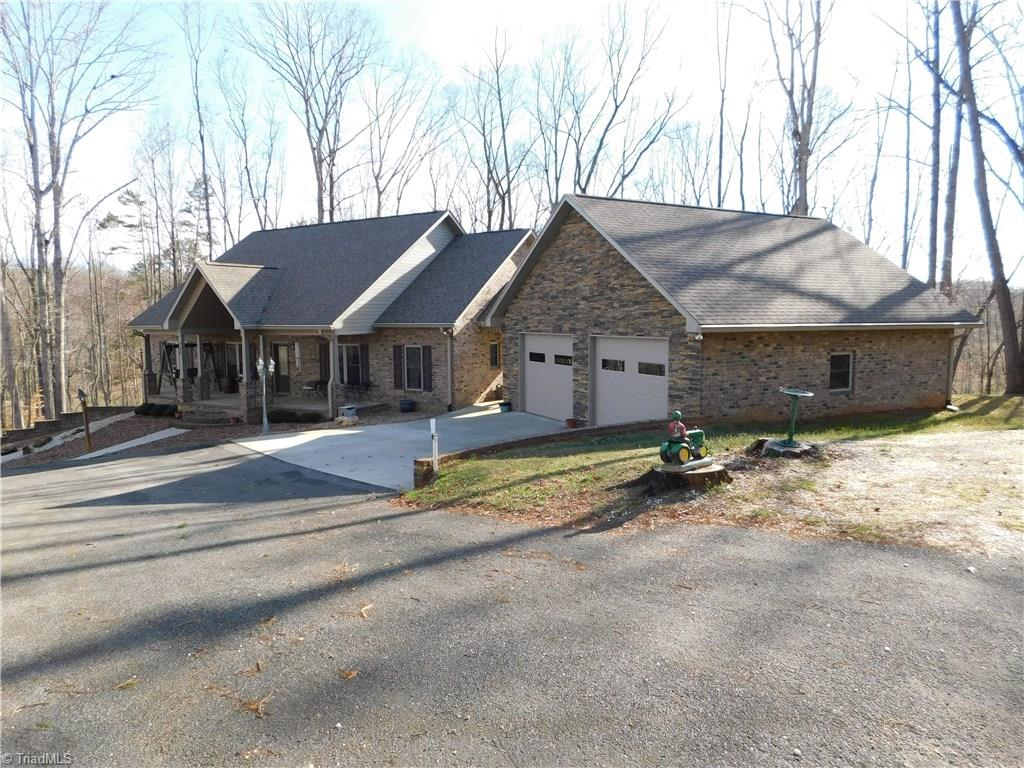 Stunning, Tumbled brick/Stacked stone home on 8 acres in rural community. Minutes from interstate, shopping and medical facilities. Home has 5 bedrooms(2 currently used as office and gym) 2 kitchens, 2 living areas, main floor laundry, custom cabinets, granite,  and walk in pantry. Huge master suite with double vanities and separate shower. Has 19 closets, screened in porch, Rocking chair front porch, 30x50 shop(220/110),wired storage building,garden space. See attachments for list of features.