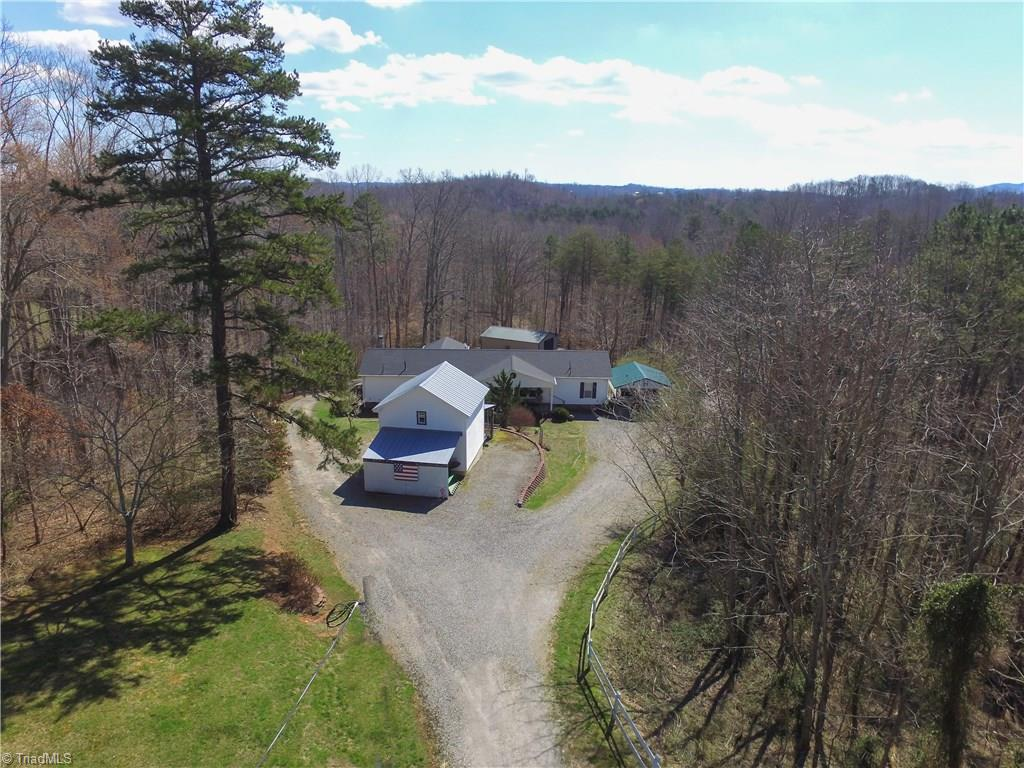 Immaculate country property on 26 acres with like new Modular. Also has 36x24 Shop, 2 car carport, and 18x18 tobacco barn storage. Home has been very well maintained.  3br/2ba, a den, living room and bonus room that could be 4th bedroom. Home has wood furnace that will heat the entire home in addition to the  Heat pump.  Storage has 2 shelters for equipment, wired and concrete floor. Shop building is fully wired and has plenty of storage with wood stove heat. Property has an abundance of wildlife also.