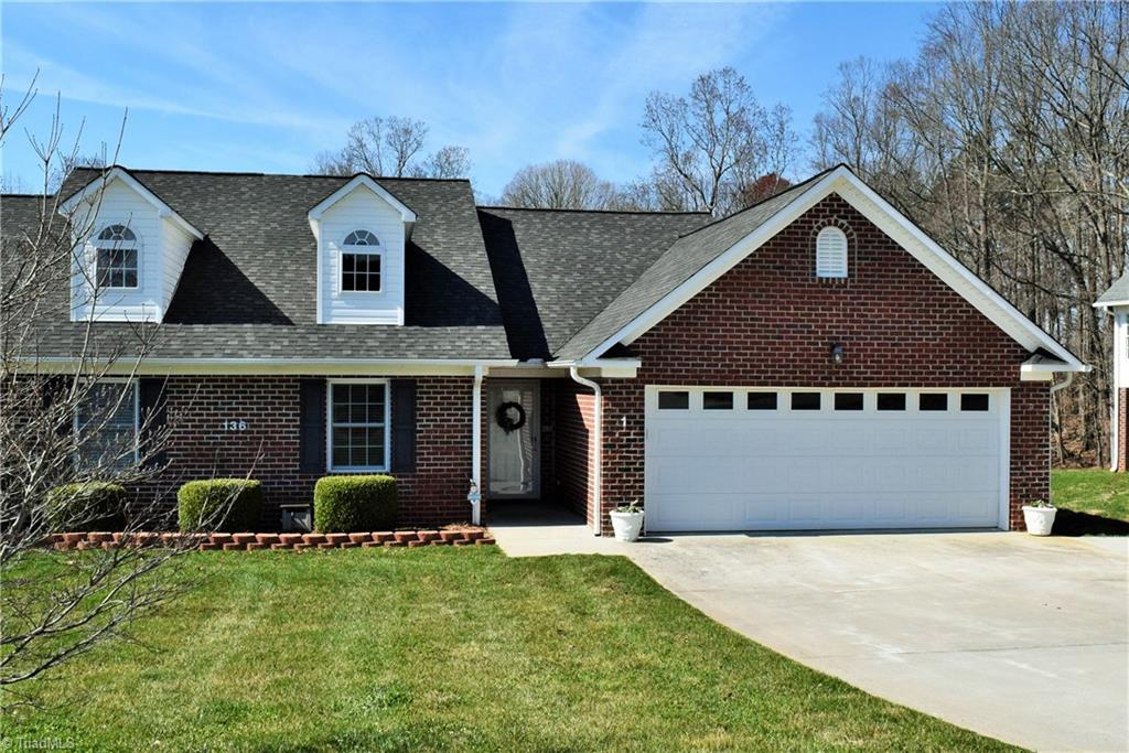 In the shadow of Pilot Mountain, Dearon Village is a great condominium grouping that keeps you close to everything - shopping in Pilot Mountain or access to highways & byways!  Immaculate, one level brick condo with 2 car attached garage features open floor plan with trey ceilings throughout. Cozy gas log fireplace, lots of closet and pantry space & back door to spacious deck overlooking the surrounding woods. Master suite has a large walk in closet, double sink vanity & shower.