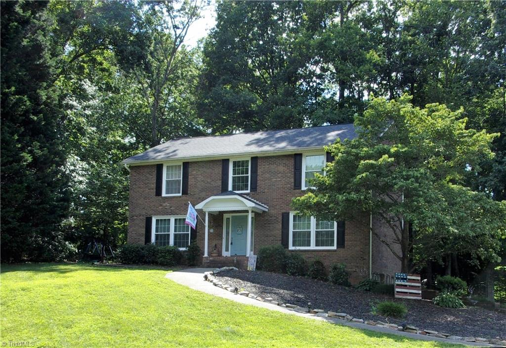 Gorgeous brick 2 story on large lot, grt location, 4BR/2.5BA,Living Room and Great Room,Great room has fireplace, large updated eat-in kitchen w/all appliances, pantry and lots of cabinets, separate dining room, large partially covered back deck which is perfect for entertaining, full basement with huge finished den w/fireplace, master suite w/skylight in master bath, paved drive, large storage building, beautiful landscaping with mature trees, USDA eligible, new windows w/warranty, A Must See!!