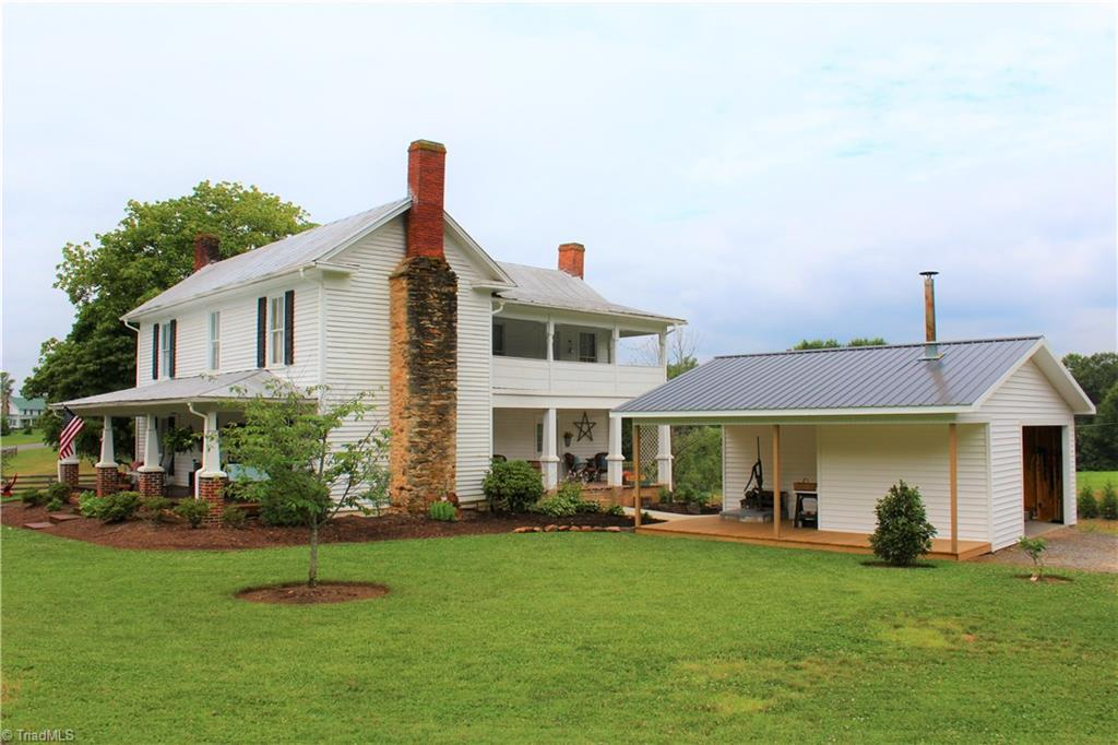 Amazingly restored 2 story farmhouse with a wonderful blend of yesteryear and modern!Home boasts heart of pine flooring throughout, ceramic in kitchen and baths, all new wiring with 200 amp service,2 hvacs,750 gallon wood stove water heater, New Garage/outbuilding, new well,5 original fireplaces restored,8 and 9 foot ceilings,3 bedroom/4 full bath,and bonus that could be used as a bedroom, new insulation through most of the home. All of this on almost 6 acres with chicken coops, barn and Spring fed pond!