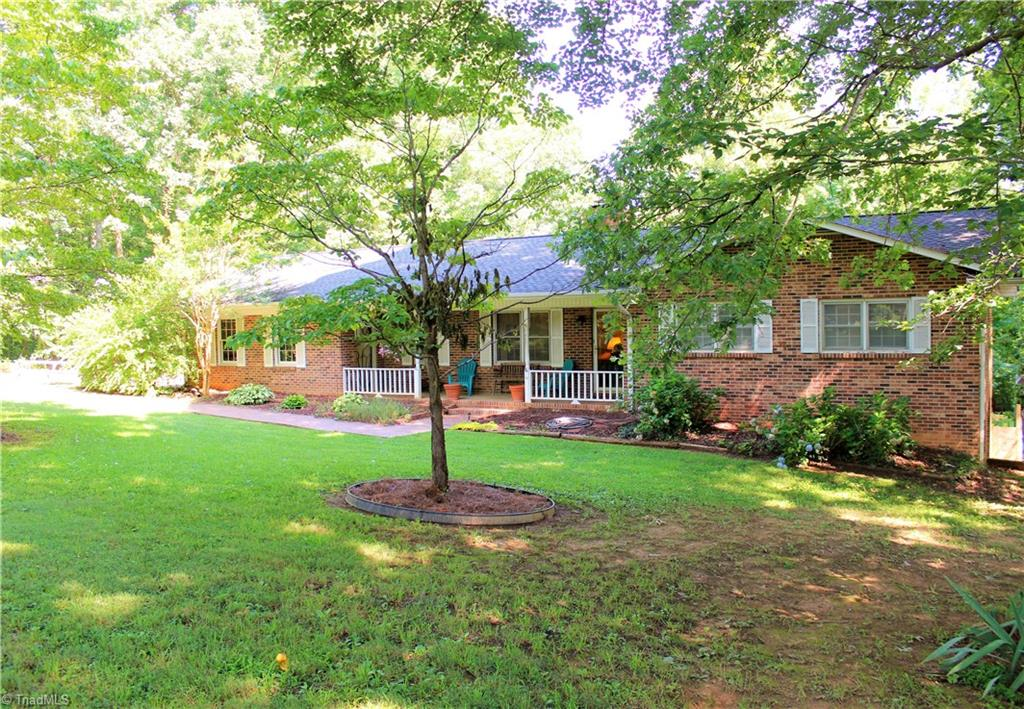 Nice brick ranch on almost 4 acres on dead end road. Home is 3 br/2 ba all brick with a full basement. Home has had recent roof, has laminate flooring through most of the home, finished rooms in the basement, large backyard, 2 car garage, and has a 20 x 18 workshop with carport shelter.  Home also has wood stove in basement that stays. Home has lots of room in the living areas and extra areas for parking.  Lots of house and land for the money!