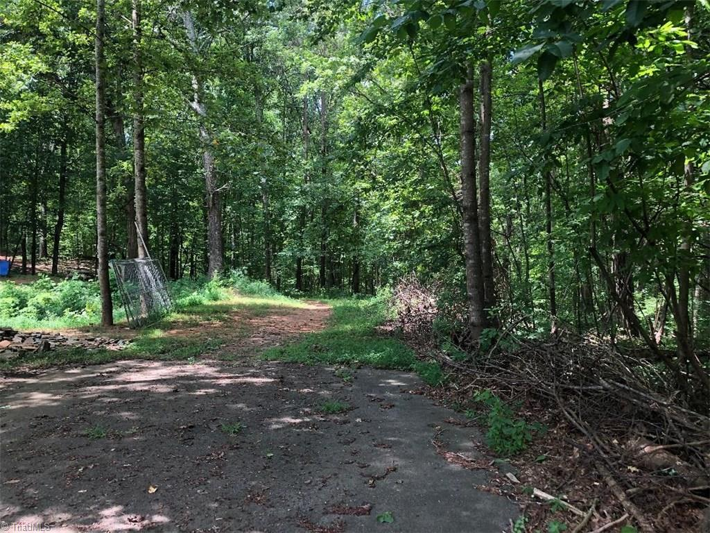 Priced under tax value!! Nice 9.23+/- acres in great location to build! Has a small stream on the property.  State right of way into property. Driveway was started years ago to potential home site.