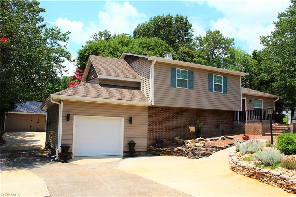 Stunning 3br/2ba home in established neighborhood in King.  Updates include recent architectural roof, Lots of concrete for access to rear of home, 16 x 16 building and 21 x 16 carport in rear, beautifully landscaped back yard with fire pit, hardwood and engineered flooring throughout with carpet in the bedrooms, granite in the kitchen, oak cabinets with stone back splash, stainless appliances,  tile showers with glass doors, including a master suite to die for! This is a must see!