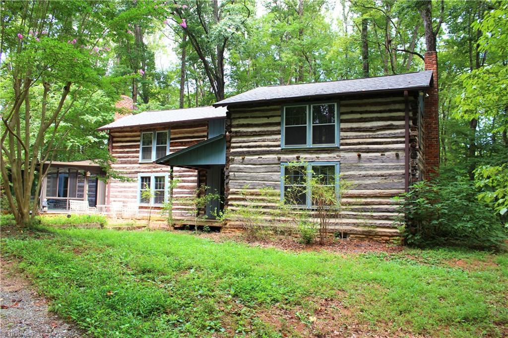 Privacy, acreage and convenience all together! 30 acres, unique log cabin home and  45 x 30 workshop.  Property is perfect for a secluded home or hunting retreat just minutes from Winston-Salem.  Home is 2 br/2ba with over 2500 square feet, large sunroom with it's own heating and cooling, and a wood burning fireplace for those chilly nights. The work shop is finished with a 3 bay garage and 2 30x12 lean-to's on the ends, shop has full bath and wired separately. Property has 2 wells and 2 septic systems.