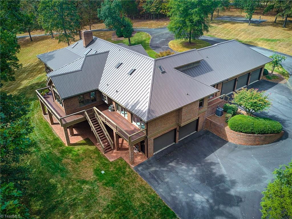 Extraordinary 39 Plus Acre Estate in Prime Triad Location! Designed by Norman Zimmerman, Custom Built One Owner Home. All the details you can imagine, including New Roof, Expansive Deck, Mostly Main Level Living. Basement is ready to be finished! 5-Bay Garage. Call Agent for more details on Additional Land Available, with 6-Car Garage!