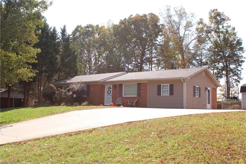 Large brick ranch with plenty of room!  Home has 3 bedrooms/3 and a half bath and also has a large bonus/den room that could be used as a bedroom. Home has been nicely remodeled with an extra large master suite added on with his and hers walk in closets, large full bathroom and office. Home boasts large concrete parking area and stamped concrete rear patio. Also included are all kitchen appliances and 12x18 storage building.  Lots of house for the money!