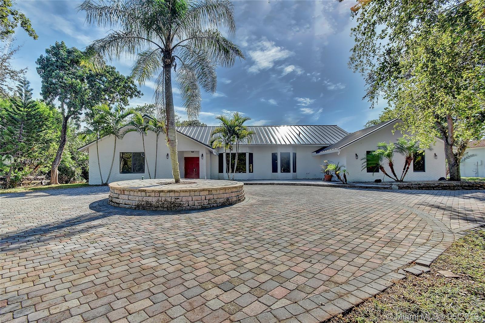 Property for sale at 3910 NW 43rd St, Coconut Creek,  Florida 33073