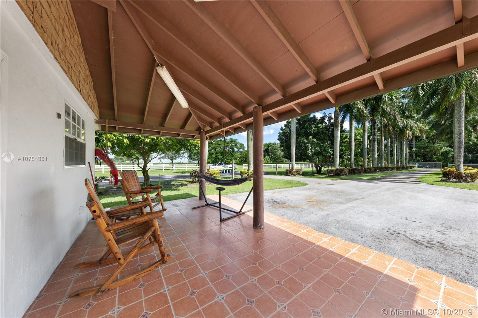 MAIN ENTRANCE BRINGS YOU STRAIGHT IN TO COTTAGE/OFFICE. THE DRIVE IS  LINED WITH ROYAL PALMS..ITS IMPRESSIVE. TH3 STABLES OFF TO THE SIDE( GROOMS QRTS). SPACIOUS OPEN LAND WITH MISC AGRI BUILDINGS
