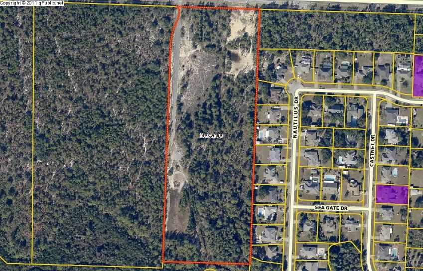 Approximately 10 Acres of High and Dry vacant land zoned HCD. Has paved road on Western boundary, storm sewer, sewer and water infrastructure in place, must be inspected by respective county departments. Possible that expired development order with plans may be reinstated by the county with little engineering updates to match existing infrastructure or modified for a different use.