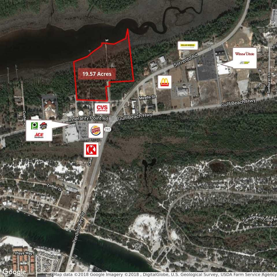 """Rare developer opportunity to purchase 19.57+/- acres of waterfront land in Pensacola, FL. The property would be an excellent site for a possible condo or residential development with its prime location just over the bridge from the Perdido Key beaches. The site consists of 6 contiguous parcels with over 1,378 feet of frontage along Bayou Tarcon. 16.57+/- Acres of the property is zoned """"C-1"""", Commercial District, which allows for a variety of commercial and residential uses. The remaining 3+/- acres of the site is zoned """"SDD"""", Special Development District which allows a maximum density of 3 dwelling units per acre. The site could potentially be developed with a total of 423 dwelling units under the current zoning laws. The property features a pier extending into the Bayou Garcon which is surrounded by wetlands on the property. All private and public utilities are available to the site.   Owner will consider subdividing the property and selling the property as individual tracts."""